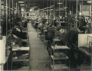 A black and white image of female radio technicians working in a row of desks