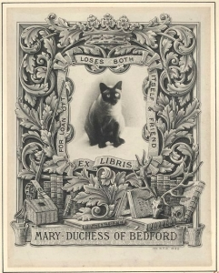 A book plate illustrating Mary Bedford's love of cats. A photo of a siamese cat sits in the centre surrounded by ornate carvings, and a frame which reads 'For Loan Oft Loses Both Itself & Friend. Ex Libris'