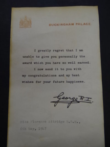 A colour photograph of a historical note from buckingham palace
