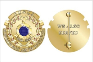 An image of the design for a circular gold badge. The left shows the front of the badge with a blue circle in the middle surrounded by a garland of leaves. The right shows the reverse of the badge, embossed with the phrase We Also Served
