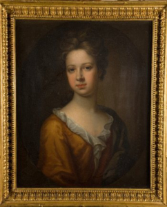 A colour portrait of a young woman with a gold frame