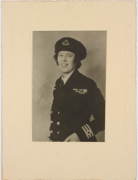 A sepia photograph of a woman in military uniform